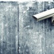 CCTV camera. Security camera on the wall. — Stock Photo