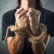 Stock Photo: Male hands tied with rope
