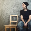 Man sitting on wooden chair and waiting — Stock Photo