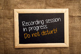 Recording session in progress. Do not disturb. — Stockfoto