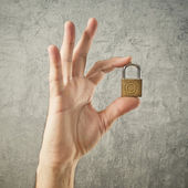 Hand holding padlock with Copyright symbol — Stock Photo