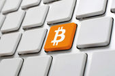 Bitcoin symbol on computer keyboard — Stock Photo