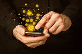 Bitcoins on smartphone — Stock Photo