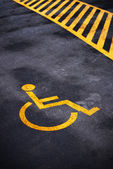 Disabled person parking place permit mark — Stock Photo