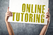 Man holding banner with ONLINE TUTORING title — Stock Photo