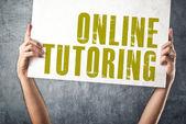 Man met banner met online tutoring titel — Stockfoto