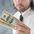Stock Photo: Businessmholding United states dollars