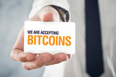 Businessman holding card with title WE ARE ACCEPTING BITCOINS — Stock Photo