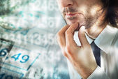 Businessman thinking about figures — Stock Photo