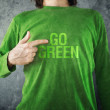 Go green. Man pointing to title printed on his shirt — Stock Photo