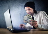 Making money online, businessman with laptop computer — Foto Stock