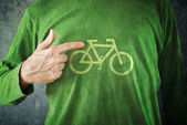 Ride your bike. Man pointing to bicycle insignia printed on his — Stock Photo