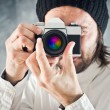 Businessman taking photo with vintage film camera — Stock Photo