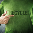 RECYCLE. Man pointing to title printed on his shirt — Stock Photo #40082883