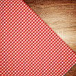 Stock Photo: Table cloth, kitchen napkin on wooden background.