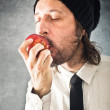 Businessman eating red apple — Stock Photo #40202609