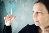 Attractive businesswoman pressing touch screen button — Stockfoto