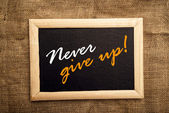 Never give up, motivational message — Stock Photo