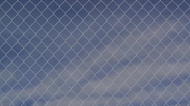 Wire fence against cloudy sky timelapse — Stock Video