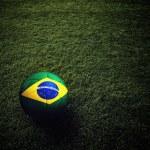 Soccer ball with Brazil flag — Stock Photo