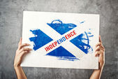 SCotland Independence flag. Man holding banner with Scotish inde — Stock Photo