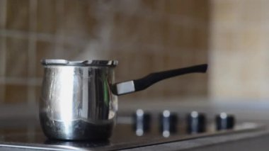 Coffee pot on cooking plate with boiling water in. — Stock Video