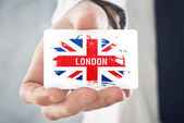 British Businessman holding business card with Great Britain Fla — Photo