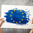 Stock Photo: EuropeUnion flag. Mholding banner with EU Flag.