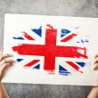 Great Britain flag. Man holding banner with British Flag. — Stock Photo