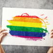 LGBT flag. Mholding banner with Gay Flag. — Stock Photo #40886751