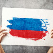 Russia flag. Man holding banner with Russian Flag. — Stock Photo