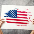 Stock Photo: Americflag. Mholding banner with USFlag.
