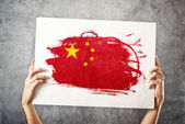 China flag. Man holding banner with Chinese Flag. — Stock Photo