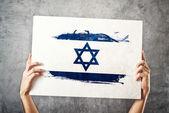 Israel flag. Man holding banner with Israelian Flag. — Stock Photo
