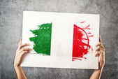 Italy flag. Man holding banner with Italian Flag. — Photo