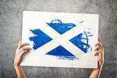 Scotland flag. Man holding banner with Scotish Flag. — Stock Photo
