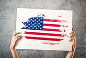 American flag. Man holding banner with USA Flag. — Stock Photo