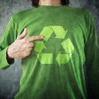RECYCLE. Man pointing to recycling symbol printed on his shirt — Stock Photo #40965649