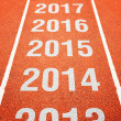 Stock Photo: Year numbers on athletics running track
