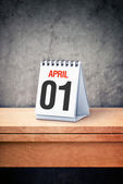 April the first, Fool's day, on table calendar — Stock Photo