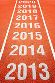 Year numbers on athletics running track — Stock Photo