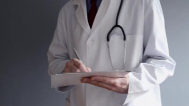 Male doctor is writing RX prescription while standing. Health care professional writing. — Stock Video