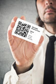 Businessman holding QR code business card — Stock Photo