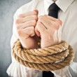 Stock Photo: Businessmwith hands tied in ropes