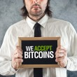 Businessmholding board with title WE ACCEPT BITCOINS — Stock Photo #41540719