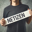 Man holding white banner with word NETIZEN printed — Foto de Stock   #41545393