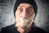 My lips are sealed. Man with tape over his mouth. — Stock Photo