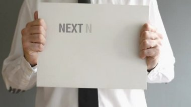 Businessman holding paper board with NEXT BIG THING AHEAD title. Business concept. — Stock Video