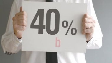 Salesman holding sale tag with forty percent sales discount price. Consumerism concept, retail store promotion. — Stock Video