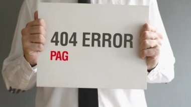 Businessman holding paper with 404 Error - Page not found title. Internet concept. — Stock Video